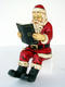 SANTA SITTING WITH BOOK